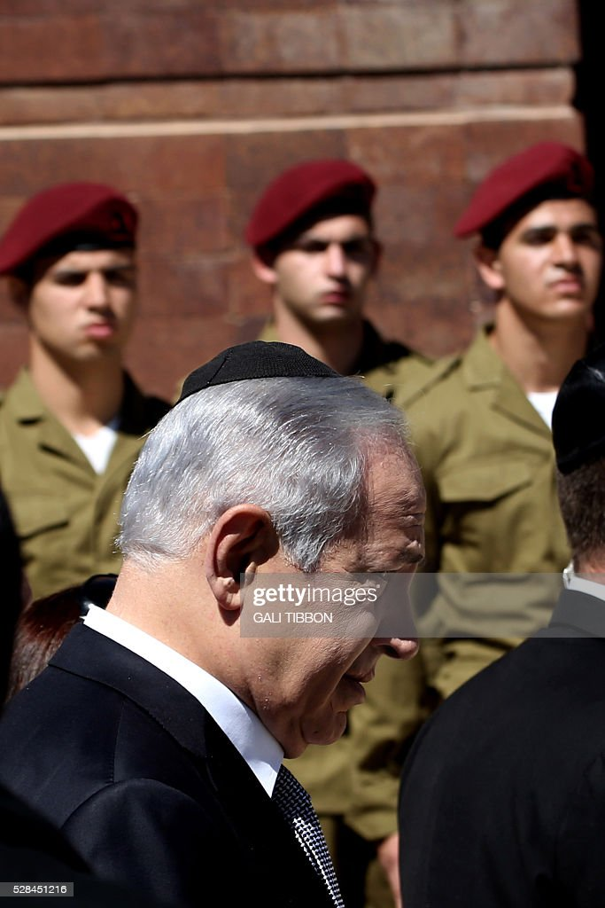 Israeli Prime Minister Benjamin Netanyahu arrives to the annual Holocaust Remembrance Day ceremony at the Yad Vashem Holocaust Memorial in Jerusalem on May 5, 2016. The state of Israel marks the annual Memorial Day commemorating the six million Jews murdered by the Nazis in the Holocaust during World War II. / AFP / GALI