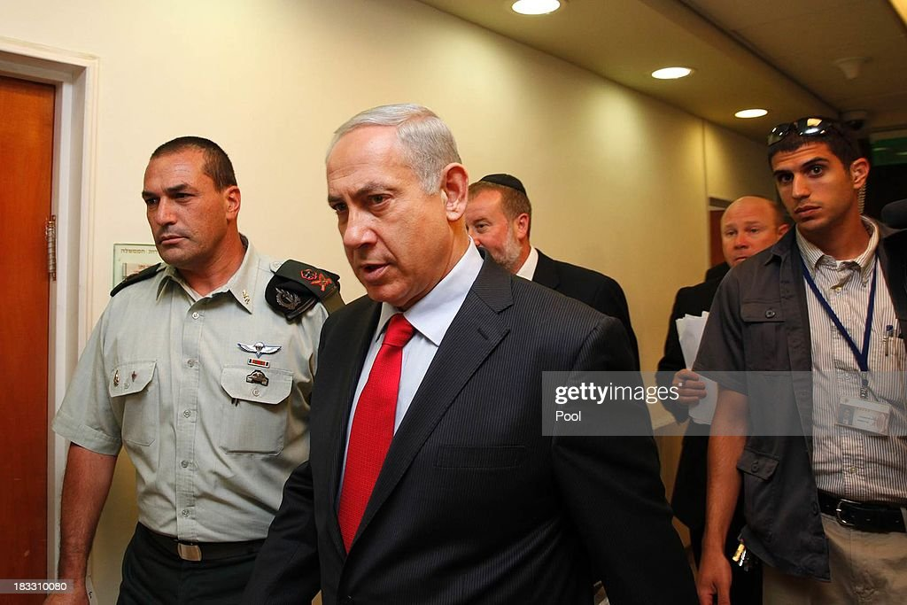 Israeli Prime Minister <a gi-track='captionPersonalityLinkClicked' href=/galleries/search?phrase=Benjamin+Netanyahu&family=editorial&specificpeople=118594 ng-click='$event.stopPropagation()'>Benjamin Netanyahu</a> arrives to the weekly cabinet meeting at his Jerusalem office on October 6, 2013 in Jerusalem, Israel. Netanyahu will give a keynote speech later today at a Bar Ilan university conference.
