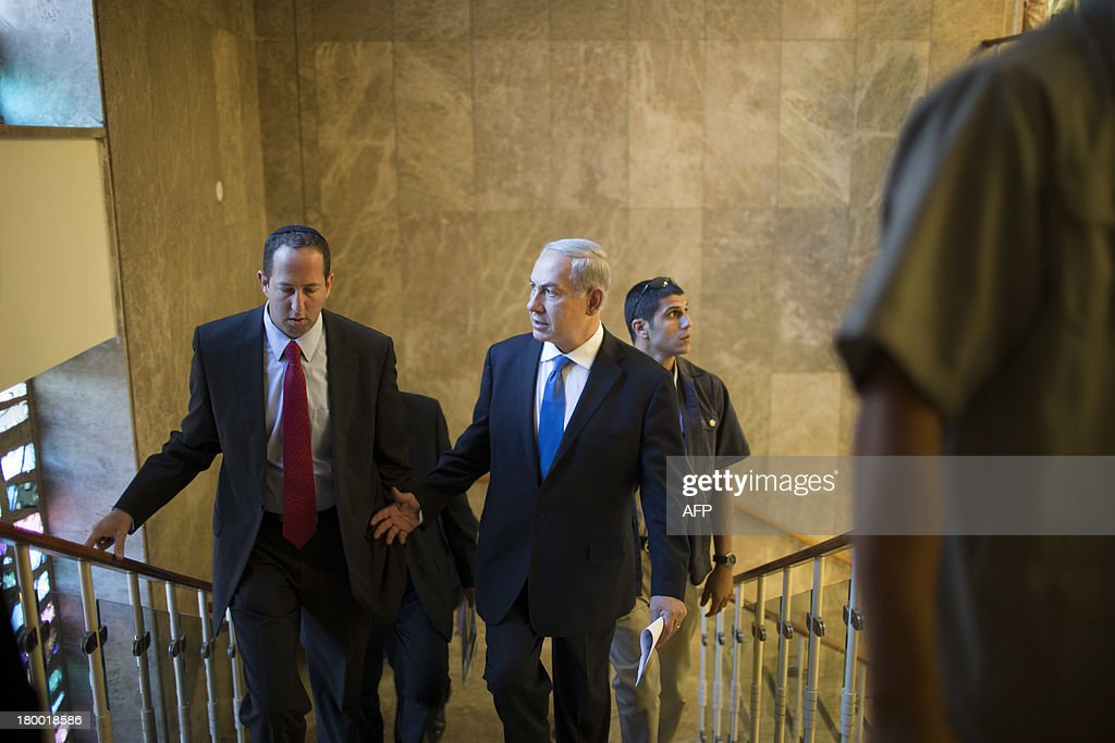 Israeli Prime Minister Benjamin Netanyahu (C) arrives to the weekly cabinet meeting in Jerusalem on September 8, 2013. Israeli Prime Minister Benjamin Netanyahu dismissed seemingly conciliatory statements from Iran as a smokescreen to divert attention from Tehran's efforts to build nuclear arms.