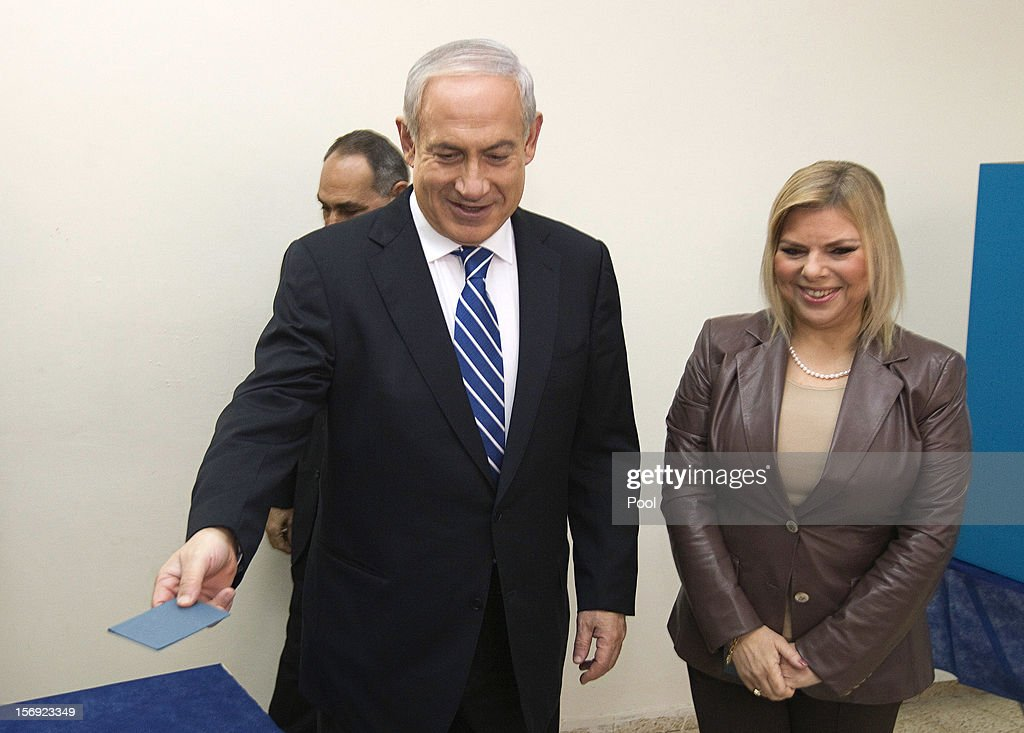 Israeli Prime Minister <a gi-track='captionPersonalityLinkClicked' href=/galleries/search?phrase=Benjamin+Netanyahu&family=editorial&specificpeople=118594 ng-click='$event.stopPropagation()'>Benjamin Netanyahu</a> arrives with his wife Sara before casting his ballot for the Likud party leadership election at a polling station in the Jewish settlement of Givat Zeev, on November 25, 2012 in the West Bank. The Likud primaries, ahead of a January 22, 2013 general election, were reported to have been marred with malfunctioning computerized voting systems at polling stations.