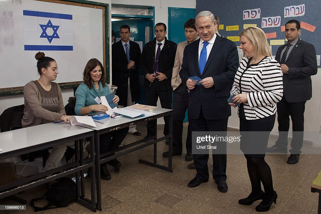 Israeli Prime Minister Benjamin Netanyahu arrives with his wife <a gi-track='captionPersonalityLinkClicked' href=/galleries/search?phrase=Sara+Netanyahu&family=editorial&specificpeople=1061079 ng-click='$event.stopPropagation()'>Sara Netanyahu</a> to cast their ballot at a polling station on election day on January 22, 2013 in Jerusalem, Israel. Israel's general election voting has begun today as polls show Netanyahu is expected to return to office with a narrow majority.