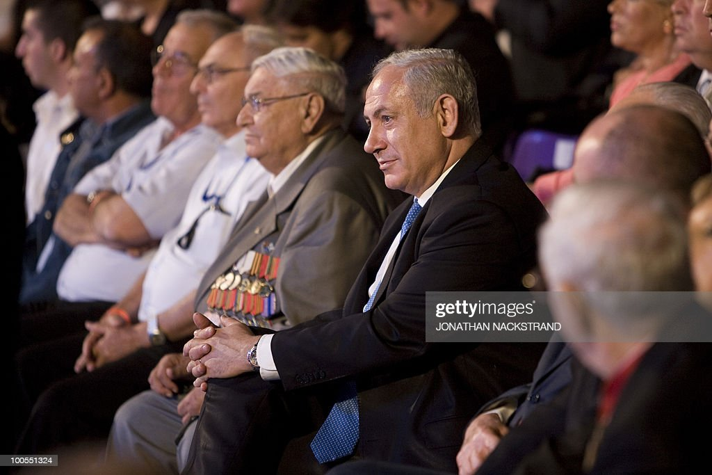 Israeli Prime Minister Benjamin Netanyahu attends a ceremony honoring World War II veterans and marking the 65th anniversary of the Allied victory over Nazi Germany at the Armored Corps Memorial and Museum at Latrun Junction near Jerusalem on May 25, 2010.