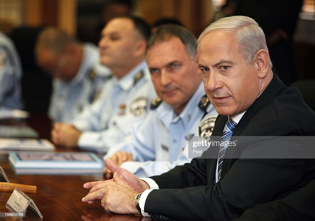 Israeli Prime Minister <a gi-track='captionPersonalityLinkClicked' href=/galleries/search?phrase=Benjamin+Netanyahu&family=editorial&specificpeople=118594 ng-click='$event.stopPropagation()'>Benjamin Netanyahu</a> attends a meeting during a visit to the national police headquarters on November 22, 2012 in Jerusalem, Israel. A ceasefire took hold on November 21 in and around Gaza after a week of cross-border violence between Israel and Palestinian militants, although a police spokesman reported that twelve rockets fired from the Gaza Strip hit Israel in the hours that followed the agreement.
