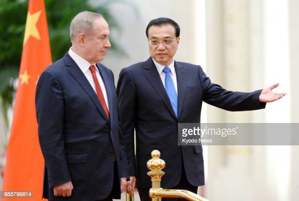 Israeli Prime Minister Benjamin Netanyahu attends a welcoming ceremony at the Great Hall of the People in Beijing on March 20 accompanied by Chinese...
