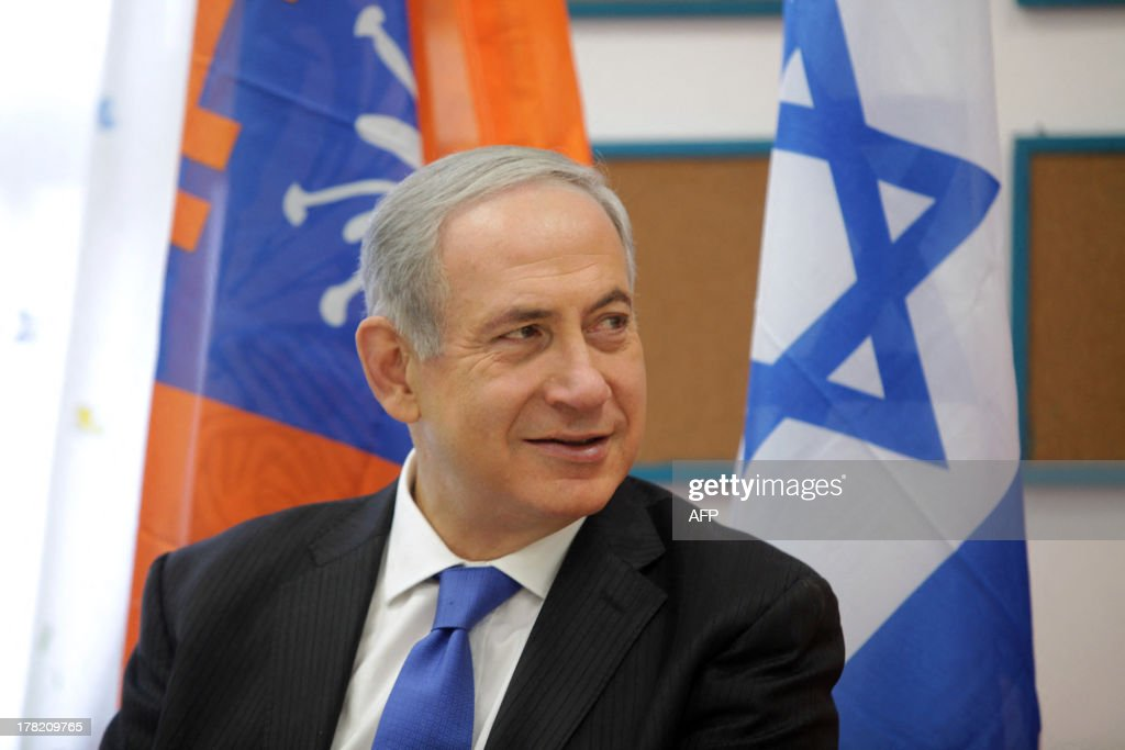 Israeli Prime Minister Benjamin Netanyahu attends an event marking the beginning of the new school year on August 27, 2013 at an elementary school in the coastal city of Netanya, north of Tel Aviv. Israel will strike back 'fiercely' if Syria attacks the Jewish state, Netanyahu said today, as the US mulled military action against President Bashar al-Assad's regime.