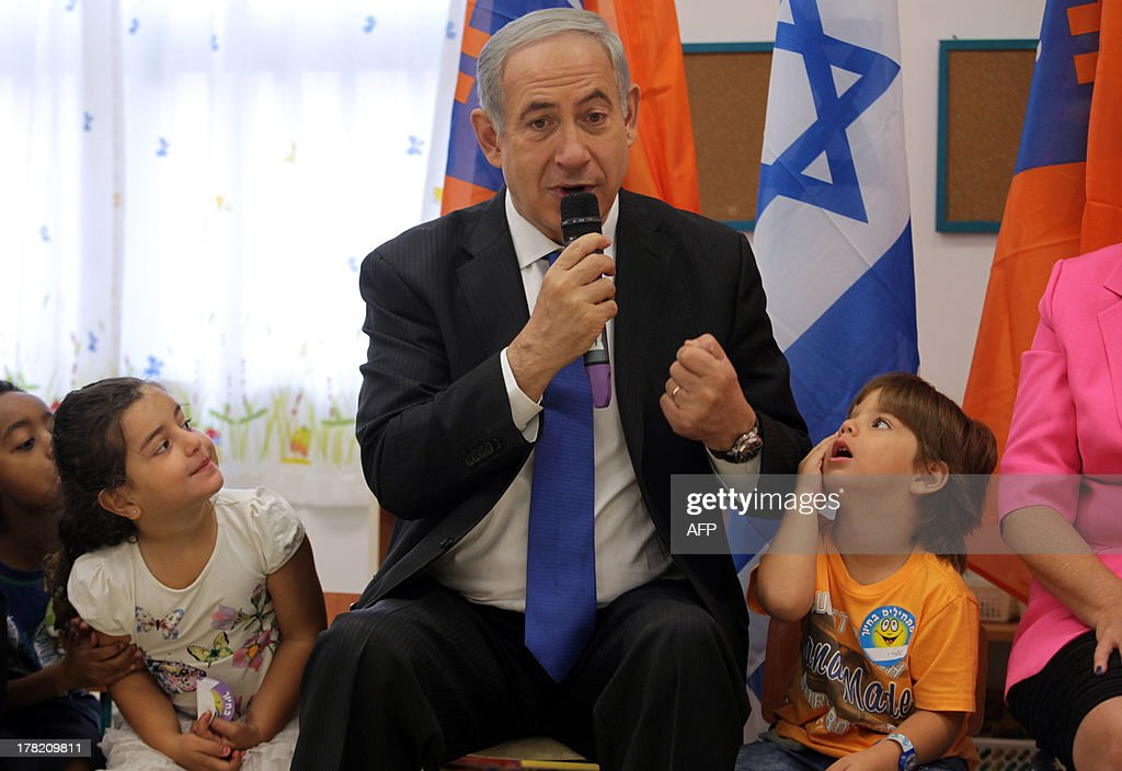 Israeli Prime Minister Benjamin Netanyahu attends an event marking the beginning of the new school year on August 27, 2013 at an elementary school in the coastal city of Netanya, north of Tel Aviv. Israel will strike back 'fiercely' if Syria attacks the Jewish state, Netanyahu said today, as the US mulled military action against President Bashar al-Assad's regime. AFP PHOTO/MAARIV/POOL == ISRAEL OUT ==