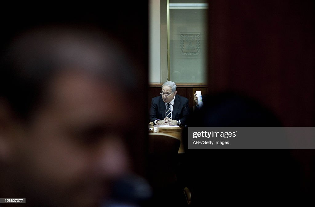 Israeli Prime Minister Benjamin Netanyahu attends the weekly cabinet meeting in his Jerusalem office on December 30, 2012. AFP PHOTO /POOL / ABIR SULTAN