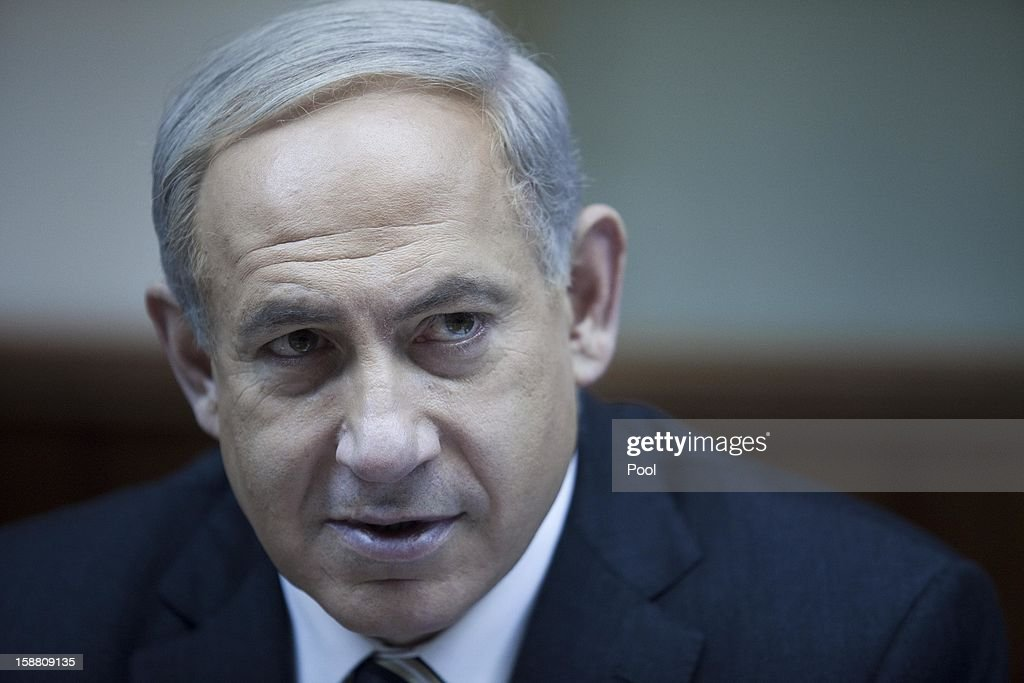 Israeli Prime Minister <a gi-track='captionPersonalityLinkClicked' href=/galleries/search?phrase=Benjamin+Netanyahu&family=editorial&specificpeople=118594 ng-click='$event.stopPropagation()'>Benjamin Netanyahu</a> attends the weekly cabinet meeting in his Jerusalem office December 30, 2012 in Jerusalem, Israel.
