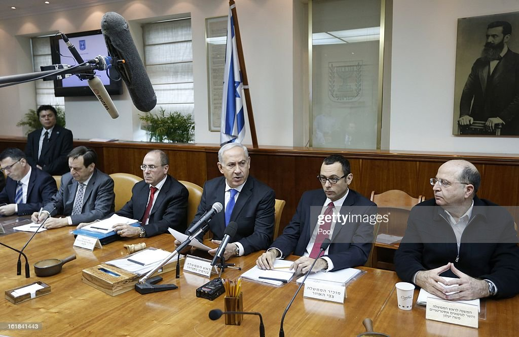 Israeli Prime Minister <a gi-track='captionPersonalityLinkClicked' href=/galleries/search?phrase=Benjamin+Netanyahu&family=editorial&specificpeople=118594 ng-click='$event.stopPropagation()'>Benjamin Netanyahu</a> (C) attends the weekly cabinet meeting on February 17, 2013 in Jerusalem, Israel. Netanyahu made a statement reaffirming his trust in the Israeli security forces and asking that they be spared undue media attention, a response made in relation to the 'Prisoner X' affair in which the suicide in Ayalon Prison of an Australin immigrant to Israel is speculated to have been espionage related and with Mossad involvement.