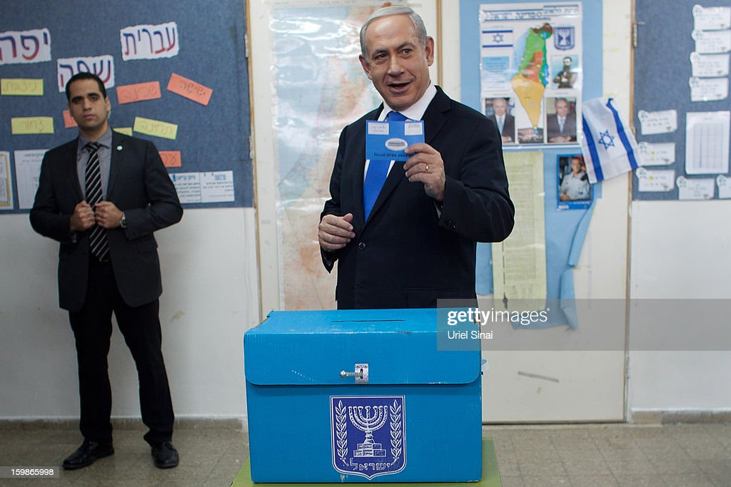 Israeli Prime Minister <a gi-track='captionPersonalityLinkClicked' href=/galleries/search?phrase=Benjamin+Netanyahu&family=editorial&specificpeople=118594 ng-click='$event.stopPropagation()'>Benjamin Netanyahu</a> casts his ballot at a polling station on election day on January 22, 2013 in Jerusalem, Israel. Israel's general election voting has begun today as polls show Netanyahu is expected to return to office with a narrow majority.