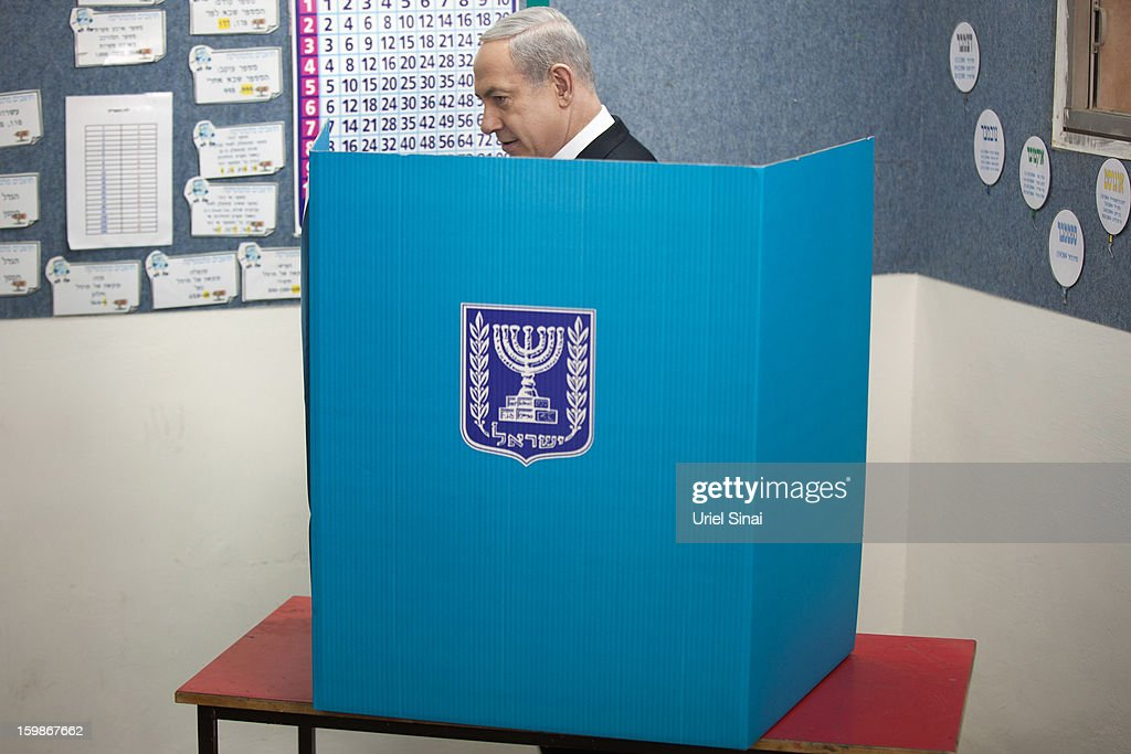 Israeli Prime Minister Benjamin Netanyahu casts his ballot at a polling station on election day on January 22, 2013 in Jerusalem, Israel. Israel's general election voting has begun today as polls show Netanyahu is expected to return to office with a narrow majority.