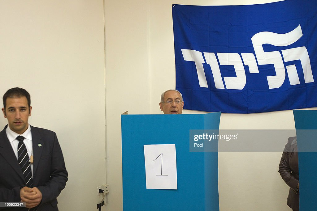 Israeli Prime Minister Benjamin Netanyahu casts his ballot for the Likud party leadership election at a polling station in the Jewish settlement of Givat Zeev, on November 25, 2012 in the West Bank. The Likud primaries, ahead of a January 22, 2013 general election, were reported to have been marred with malfunctioning computerized voting systems at polling stations.