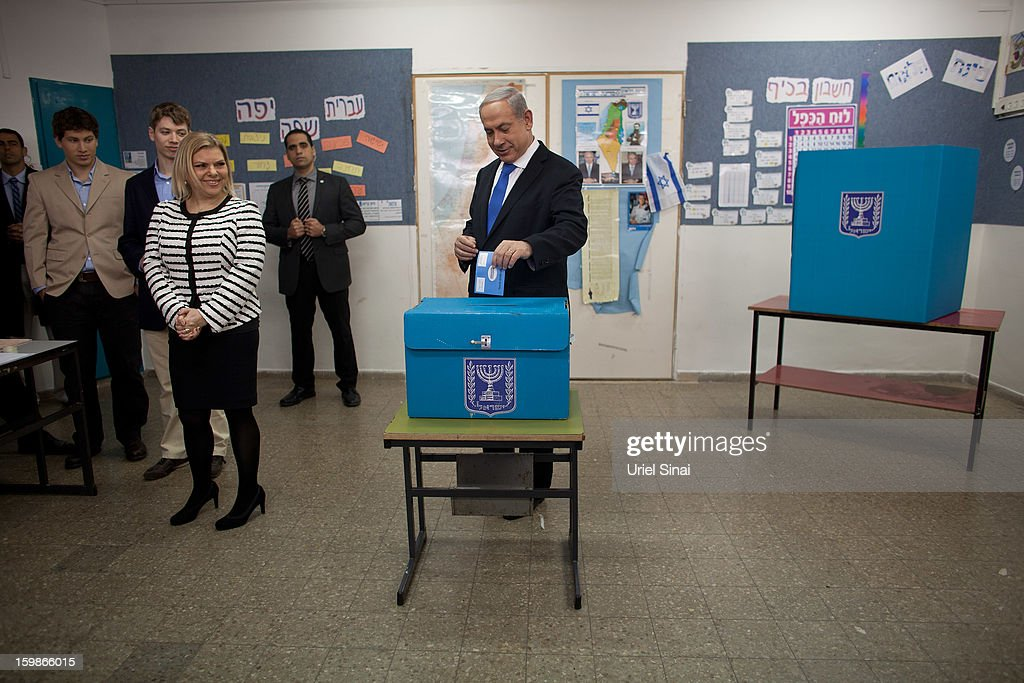 Israeli Prime Minister Benjamin Netanyahu casts his ballot watched by wife Sara Netanyahu and sons Yair Netanyahu and Avner Netanyahu at a polling station on election day on January 22, 2013 in Jerusalem, Israel. Israel's general election voting has begun today as polls show Netanyahu is expected to return to office with a narrow majority.