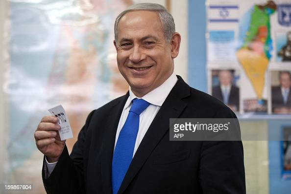 Israeli Prime Minister Benjamin Netanyahu casts his vote at a polling station in Jerusalem on January 22 as Israel residents started to vote in the...