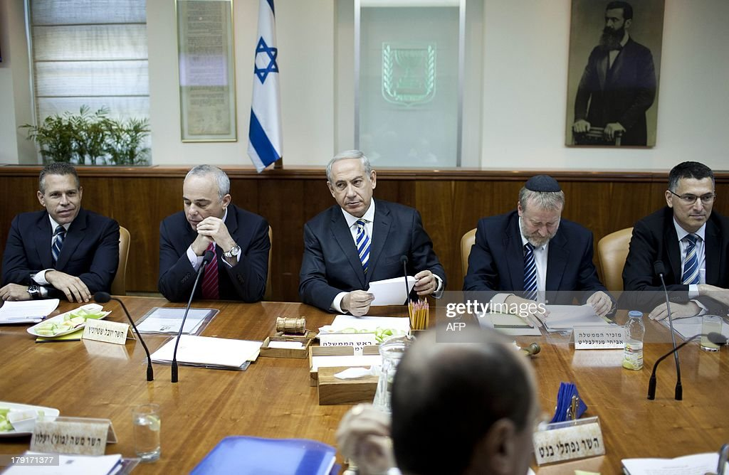 Israeli Prime Minister Benjamin Netanyahu (C) chairs the weekly cabinet meeting in Jerusalem on September 1, 2013. The Israeli cabinet authorised on August 28 a partial call-up of army reservists amid growing expectations of a foreign military strike on neighbouring Syria, army radio reported.