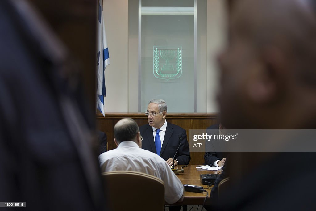 Israeli Prime Minister Benjamin Netanyahu chairs the weekly cabinet meeting in Jerusalem on September 8, 2013. Israeli Prime Minister Benjamin Netanyahu dismissed seemingly conciliatory statements from Iran as a smokescreen to divert attention from Tehran's efforts to build nuclear arms.