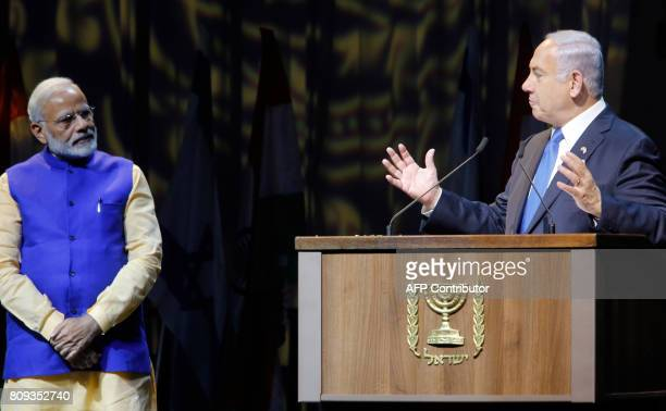 Israeli Prime Minister Benjamin Netanyahu delivers a speech as he stands next to his Indian counterpart Narendra Modi during a meeting with Indian...