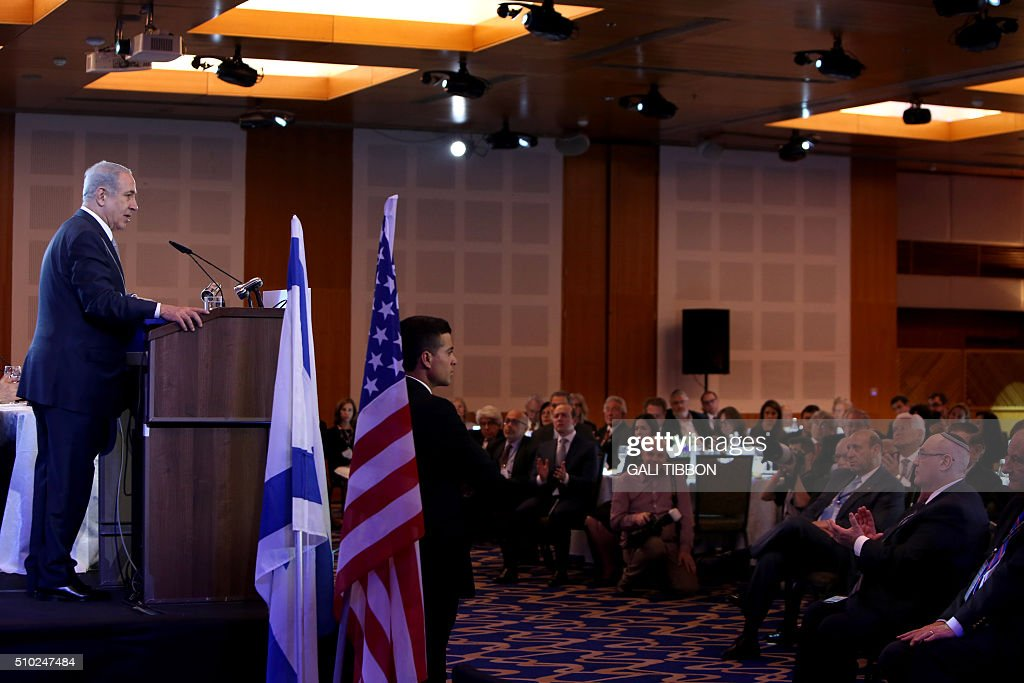 Israeli Prime Minister Benjamin Netanyahu delivers a speech at the Conference of Presidents of Major American Jewish Organizations on February 14, 2016 in Jerusalem. / AFP / GALI TIBBON