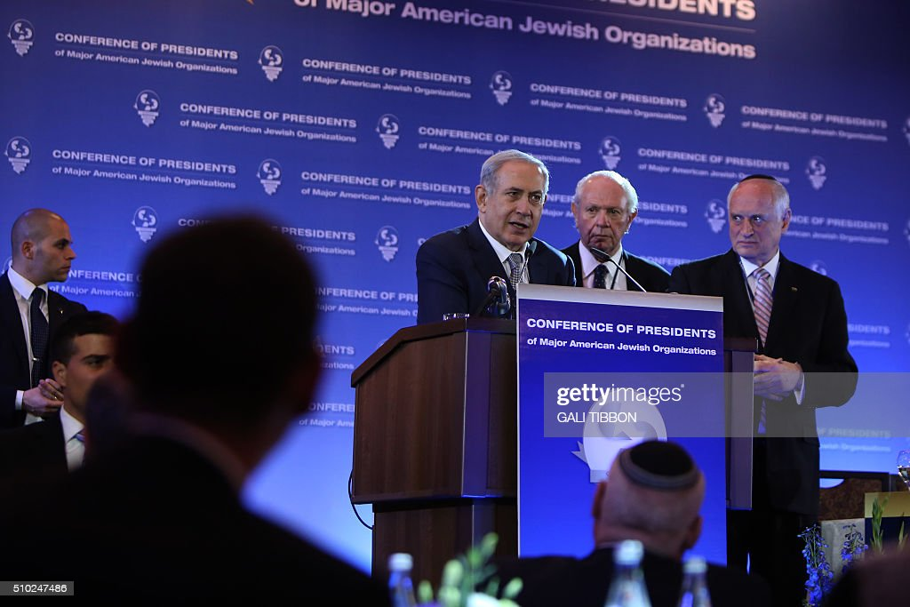 Israeli Prime Minister Benjamin Netanyahu (C-L) delivers a speech at the Conference of Presidents of Major American Jewish Organizations on February 14, 2016 in Jerusalem. / AFP / GALI TIBBON