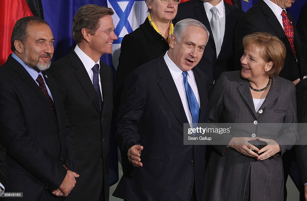 Israeli Prime Minister <a gi-track='captionPersonalityLinkClicked' href=/galleries/search?phrase=Benjamin+Netanyahu&family=editorial&specificpeople=118594 ng-click='$event.stopPropagation()'>Benjamin Netanyahu</a>, flanked by German Chancellor <a gi-track='captionPersonalityLinkClicked' href=/galleries/search?phrase=Angela+Merkel&family=editorial&specificpeople=202161 ng-click='$event.stopPropagation()'>Angela Merkel</a> (R), German Foreign Minister <a gi-track='captionPersonalityLinkClicked' href=/galleries/search?phrase=Guido+Westerwelle&family=editorial&specificpeople=208748 ng-click='$event.stopPropagation()'>Guido Westerwelle</a> (C-L) and Israeli Foreign Minister <a gi-track='captionPersonalityLinkClicked' href=/galleries/search?phrase=Avigdor+Lieberman&family=editorial&specificpeople=652650 ng-click='$event.stopPropagation()'>Avigdor Lieberman</a> (L), arrives for a group photo op at the Chancellery on January 18, 2010 in Berlin, Germany. Netanyahu and his delegation are in Berlin for a round of German-Israeli government consultations.