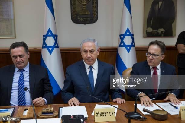 Israeli Prime Minister Benjamin Netanyahu flanked by Government Secretary Tzachi Braverman and Minister of Transportation Israel Katz attends the...