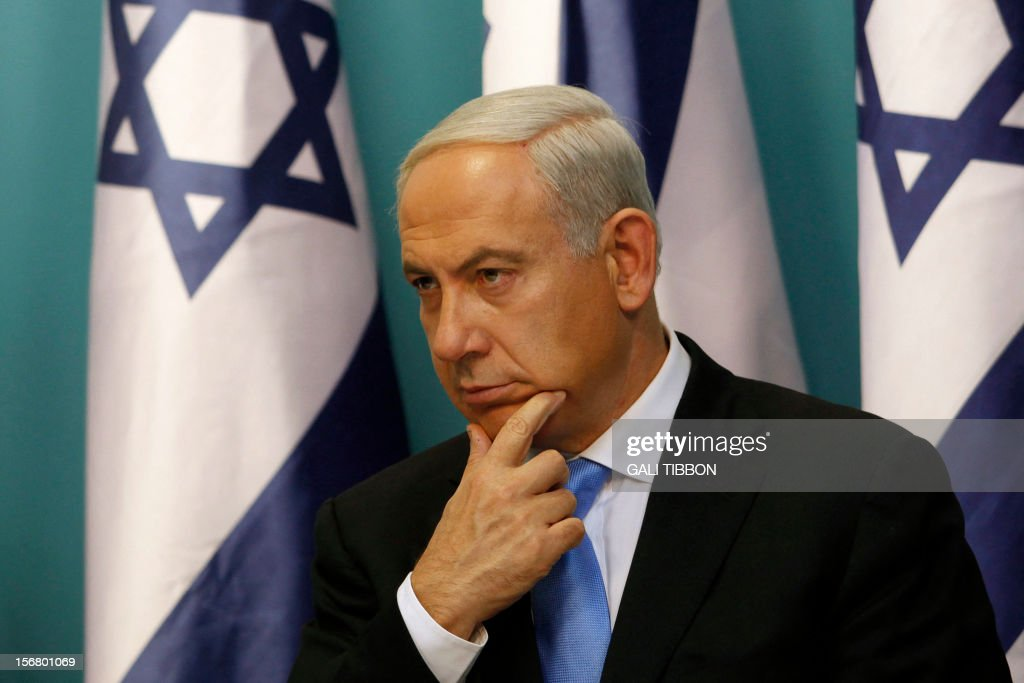 Israeli Prime Minister Benjamin Netanyahu gestures as he delivers a statement to the press at his Jerusalem office on November 21, 2012. Israel and Hamas agreed on a truce that will take effect this evening in a bid to end a week of bloodshed in and around Gaza that has killed more than 150 people, Egypt and the United States said.