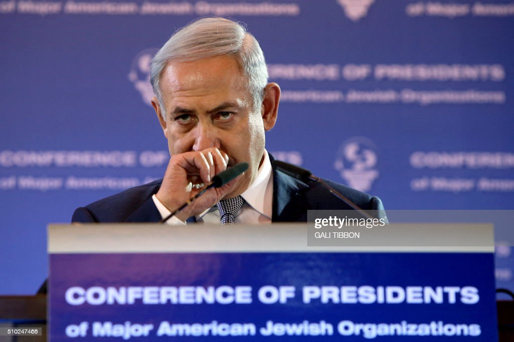 Israeli Prime Minister Benjamin Netanyahu gestures as he delivers a speech at the Conference of Presidents of Major American Jewish Organizations on February 14, 2016 in Jerusalem. / AFP / GALI TIBBON