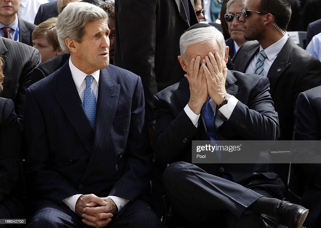 Israeli Prime Minister <a gi-track='captionPersonalityLinkClicked' href=/galleries/search?phrase=Benjamin+Netanyahu&family=editorial&specificpeople=118594 ng-click='$event.stopPropagation()'>Benjamin Netanyahu</a> (R) gestures as he speaks to US Secretary of State <a gi-track='captionPersonalityLinkClicked' href=/galleries/search?phrase=John+Kerry&family=editorial&specificpeople=154885 ng-click='$event.stopPropagation()'>John Kerry</a> during the annual ceremony for Holocaust Remembrance Day at the Yad Vashem memorial on April 8, 2013 in Jerusalem, Israel. Across the world, people commemorated the six million Jews murdered by the Nazi regime during World War II between 1933 and 1945. U.S. Secretary of State <a gi-track='captionPersonalityLinkClicked' href=/galleries/search?phrase=John+Kerry&family=editorial&specificpeople=154885 ng-click='$event.stopPropagation()'>John Kerry</a>'s visit is in an attempt to restart mideast peace talks between Israeli and Palestinians officials.
