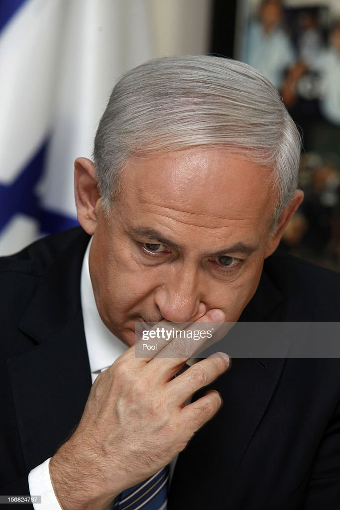 Israeli Prime Minister Benjamin Netanyahu gestures during a visit to the national police headquarters on November 22, 2012 in Jerusalem, Israel. A ceasefire took hold on November 21 in and around Gaza after a week of cross-border violence between Israel and Palestinian militants, although a police spokesman reported that twelve rockets fired from the Gaza Strip hit Israel in the hours that followed the agreement.