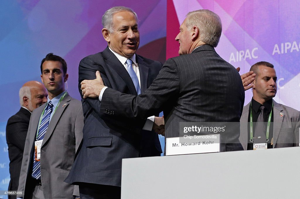 Israeli Prime Minister Benjamin Netanyahu (2nd L) greets American Israel Public Affairs Committee Executive Director Howard Kohr (3rd L) before addressing AIPAC's Policy Conference at the Walter Washington Convention Center March 4, 2014 in Washington, DC. Netanyahu met with President Barack Obama for three hours Monday at the White House where the two leaders discussed ongoing negotiations with Iran about its nuclear program and the faltering Israel-Palestinian peace talks.