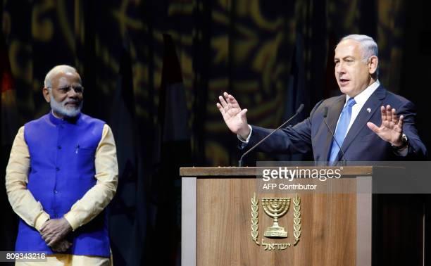 Israeli Prime Minister Benjamin Netanyahu greets his Indian counterpart Narendra Modi during a meeting with Indian community at the Tel Aviv...
