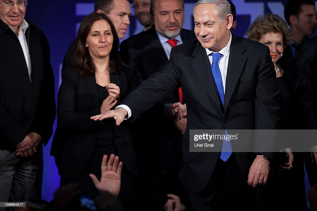 Israeli Prime Minister Benjamin Netanyahu greets his supporters at his election campaign headquarters on Janurary 23, 2013 in Tel Aviv, Israel. Exit polls suggested that current Prime Minister Benjamin Netanyahu will return to office, although he performed worse than expected.
