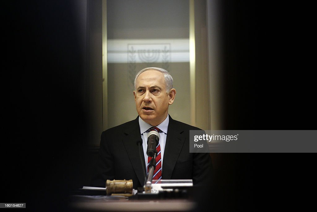Israeli Prime Minister <a gi-track='captionPersonalityLinkClicked' href=/galleries/search?phrase=Benjamin+Netanyahu&family=editorial&specificpeople=118594 ng-click='$event.stopPropagation()'>Benjamin Netanyahu</a> heads the first weekly Cabinet meeting since the nation's General Election, at his office on January 27, 2013 in Jerusalem, Israel. Netanyahu returned to office after being narrowly re-elected for a third term in the General Election held on January 22, which had the highest turnout of voters since 1999. Netanyahu now faces the task of building a coalition government.