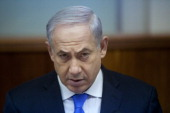 Israeli Prime Minister Benjamin Netanyahu heads the weekly cabinet meeting in his office on May 13 2013 in Jerusalem Israel The meeting comes as...