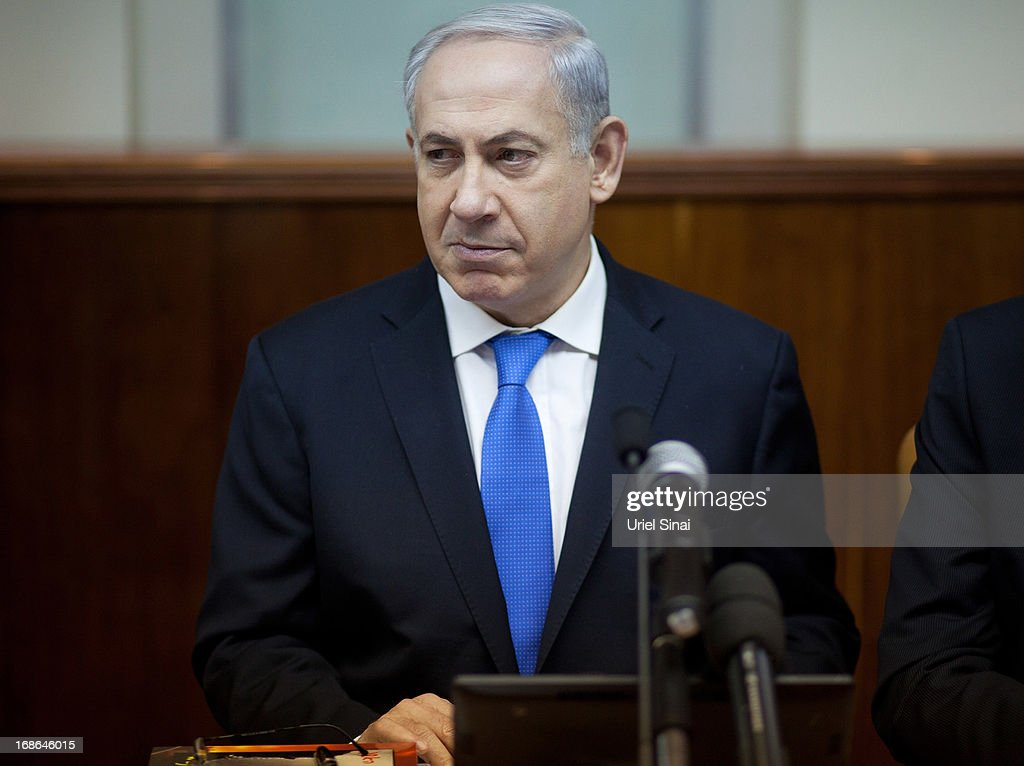 Israeli Prime Minister <a gi-track='captionPersonalityLinkClicked' href=/galleries/search?phrase=Benjamin+Netanyahu&family=editorial&specificpeople=118594 ng-click='$event.stopPropagation()'>Benjamin Netanyahu</a> heads the weekly cabinet meeting in his office on May 13, 2013 in Jerusalem, Israel. The meeting comes as Netanyahu faces criticism over reports that 127,000 USD of public money was spent on fitting sleeping quarters on his flight to the UK for Margaret Thatcher's funeral.