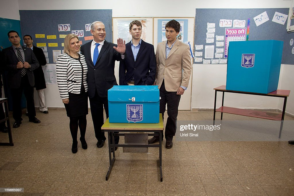 Israeli Prime Minister Benjamin Netanyahu, his wife Sara Netanyahu and sons Yair Netanyahu and Avner Netanyahu pose for a photograph after castsing their ballot at a polling station on election day on January 22, 2013 in Jerusalem, Israel. Israel's general election voting has begun today as polls show Netanyahu is expected to return to office with a narrow majority.