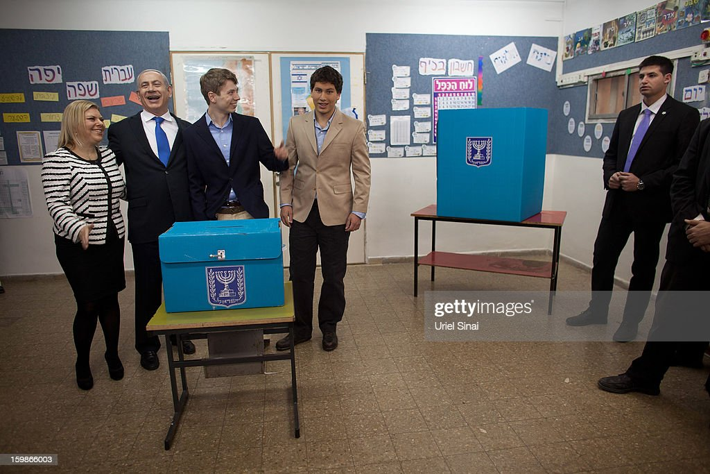 Israeli Prime Minister Benjamin Netanyahu, his wife Sara Netanyahu and sons Yair Netanyahu and Avner Netanyahu pose for a photograph after casting their ballot at a polling station on election day on January 22, 2013 in Jerusalem, Israel. Israel's general election voting has begun today as polls show Netanyahu is expected to return to office with a narrow majority.
