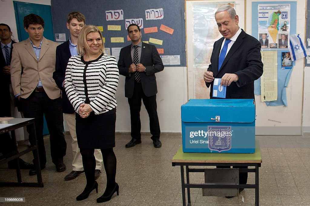 Israeli Prime Minister <a gi-track='captionPersonalityLinkClicked' href=/galleries/search?phrase=Benjamin+Netanyahu&family=editorial&specificpeople=118594 ng-click='$event.stopPropagation()'>Benjamin Netanyahu</a>, his wife <a gi-track='captionPersonalityLinkClicked' href=/galleries/search?phrase=Sara+Netanyahu&family=editorial&specificpeople=1061079 ng-click='$event.stopPropagation()'>Sara Netanyahu</a> and sons <a gi-track='captionPersonalityLinkClicked' href=/galleries/search?phrase=Yair+Netanyahu&family=editorial&specificpeople=1199388 ng-click='$event.stopPropagation()'>Yair Netanyahu</a> and <a gi-track='captionPersonalityLinkClicked' href=/galleries/search?phrase=Avner+Netanyahu&family=editorial&specificpeople=1051545 ng-click='$event.stopPropagation()'>Avner Netanyahu</a> pose for a photograph after casting their ballot at a polling station on election day on January 22, 2013 in Jerusalem, Israel. Israel's general election voting has begun today as polls show Netanyahu is expected to return to office with a narrow majority.
