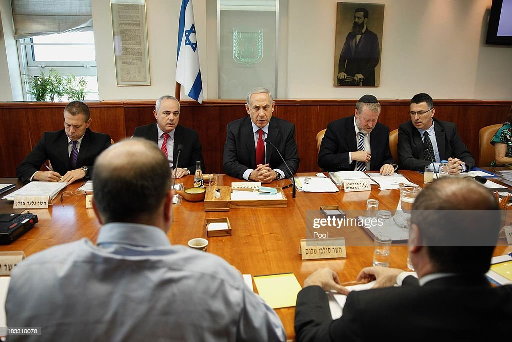 Israeli Prime Minister <a gi-track='captionPersonalityLinkClicked' href=/galleries/search?phrase=Benjamin+Netanyahu&family=editorial&specificpeople=118594 ng-click='$event.stopPropagation()'>Benjamin Netanyahu</a> holds the weekly cabinet meeting at his Jerusalem office on October 6, 2013 in Jerusalem, Israel. Netanyahu will give a keynote speech later today at a Bar Ilan university conference.