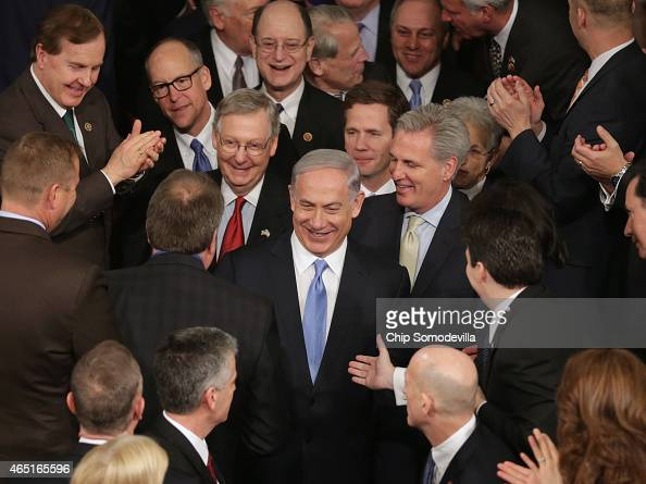 Israeli Prime Minister Benjamin Netanyahu is greeted by members of Congress as he arrives to speak during a joint meeting of the United States...