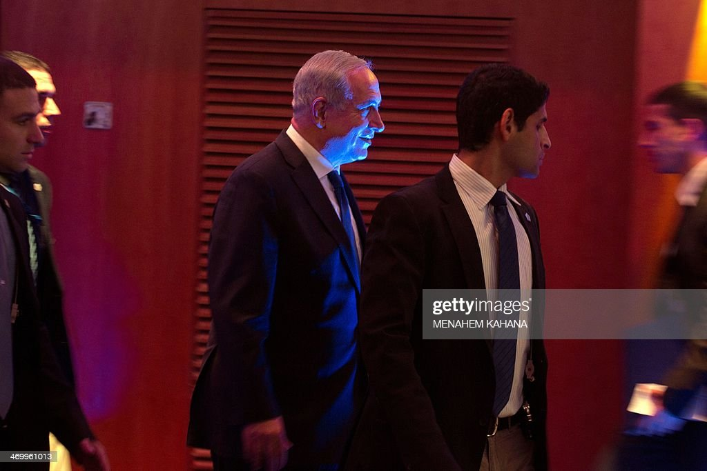 Israeli Prime Minister Benjamin Netanyahu (C) is surrounded by his bodyguards as he arrives at the opening of the Conference of Presidents of Major American Jewish Organizations, 40th Annual Leadership Mission, on February 17, 2014 in Jerusalem. AFP PHOTO/MENAHEM KAHANA