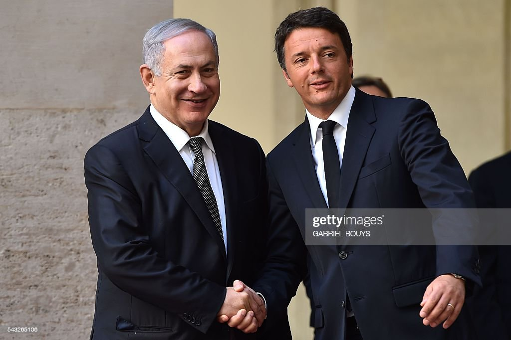 Israeli Prime Minister Benjamin Netanyahu (L) is welcomed by Italy's Prime Minister Matteo Renzi on June 27, 2016 prior their meeting at the Palazzo Chigi in Rome. Netanyahu met US Secretary Of State John Kerry earlier today and confirmed that Israel has agreed a deal to thaw relations with Turkey and said it would be a huge boost for the economy. / AFP / GABRIEL