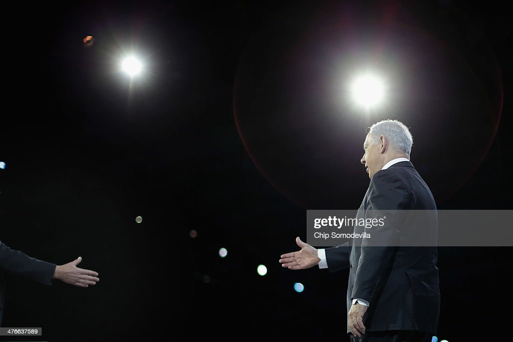 Israeli Prime Minister <a gi-track='captionPersonalityLinkClicked' href=/galleries/search?phrase=Benjamin+Netanyahu&family=editorial&specificpeople=118594 ng-click='$event.stopPropagation()'>Benjamin Netanyahu</a> (R) is welcomed to the stage by American Israel Public Affairs Committee President Michael Kassen during AIPAC's Policy Conference at the Walter Washington Convention Center March 4, 2014 in Washington, DC. Netanyahu met with President Barack Obama for three hours Monday at the White House where the two leaders discussed ongoing negotiations with Iran about its nuclear program and the faltering Israel-Palestinian peace talks.