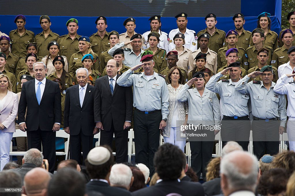 Israeli Prime Minister Benjamin Netanyahu (L) Israeli President Shimon Peres (2, L), Minister of Defence Moshe Yaalon (3rd, L) and IDF chief of staff Benny Gantz (4th, L) stand for the National Anthem during a 'Singing Independence' ceremony in honour of outstanding soldiers, as part of Israel's 65th Independence Day celebrations, at the President's Residence on April 16, 2013 in Jerusalem, Israel. 120 outstanding soldiers and officers were honoured during the event.