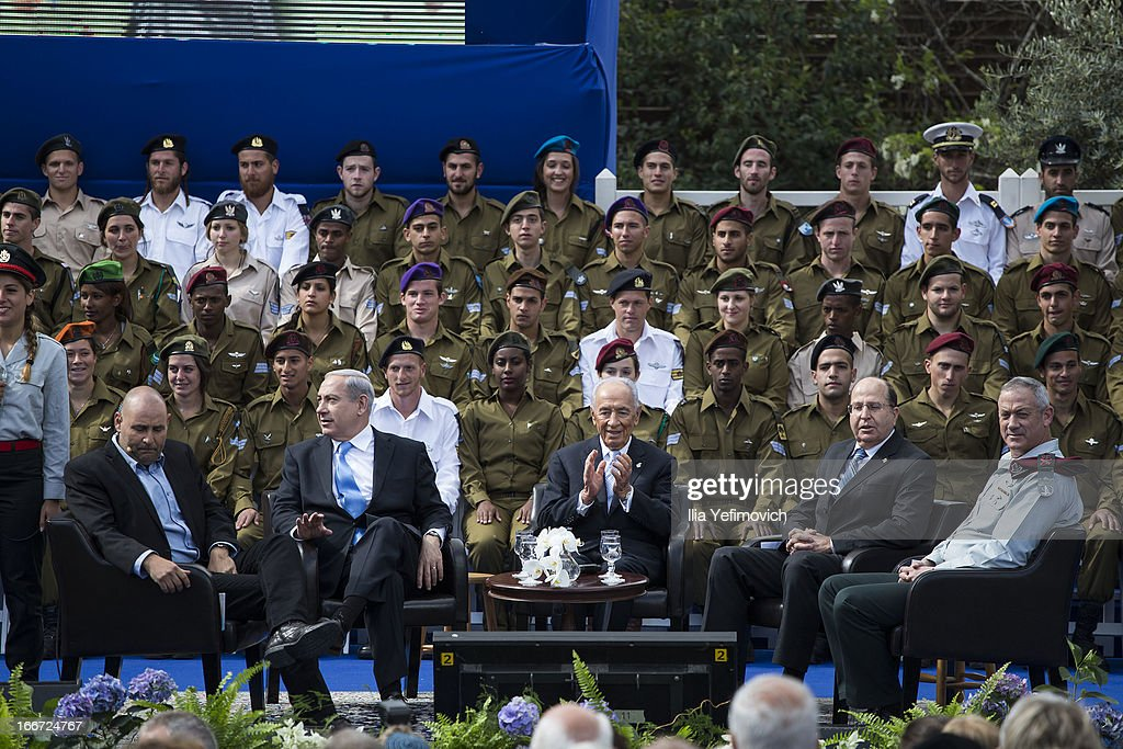Israeli Prime Minister Benjamin Netanyahu (2nd, L) Israeli President Shimon Peres (C), Minister of Defence Moshe Yaalon (2,R) and IDF chief of staff Benny Gantz (R) attend a 'Singing Independence' ceremony in honour of outstanding soldiers, as part of Israel's 65th Independence Day celebrations, at the President's Residence on April 16, 2013 in Jerusalem, Israel. 120 outstanding soldiers and officers were honoured during the event.