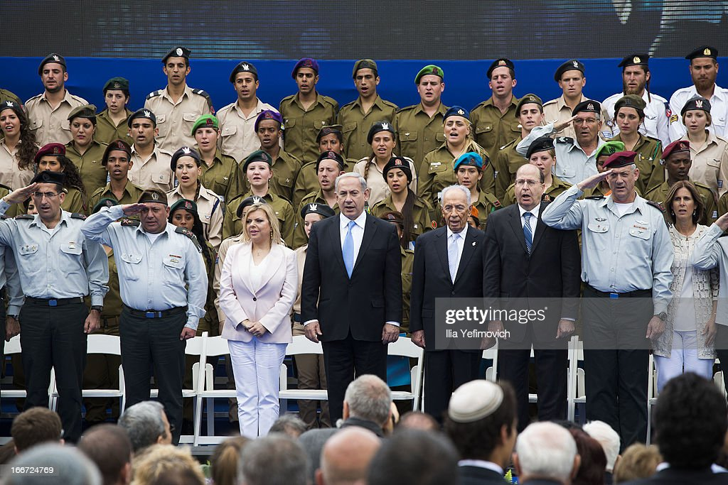 Israeli Prime Minister Benjamin Netanyahu (5th, R) Israeli President Shimon Peres (4th, R), Minister of Defence Moshe Yaalon (3rd, R) and IDF chief of staff Benny Gantz (2nd, R) stand for the National Anthem during a 'Singing Independence' ceremony in honour of outstanding soldiers, as part of Israel's 65th Independence Day celebrations, at the President's Residence on April 16, 2013 in Jerusalem, Israel. 120 outstanding soldiers and officers were honoured during the event.