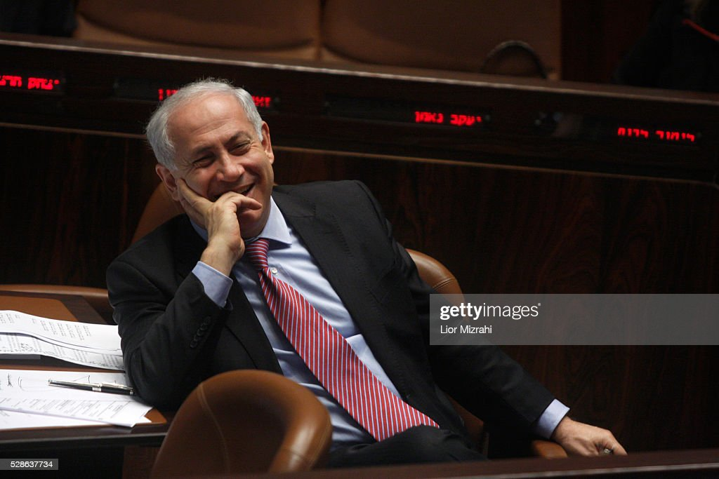 Israeli Prime Minister Benjamin Netanyahu laughs during a session of the Knesset, Israeli Parliament, on March 03, 2010 in Jerusalem, Israel.