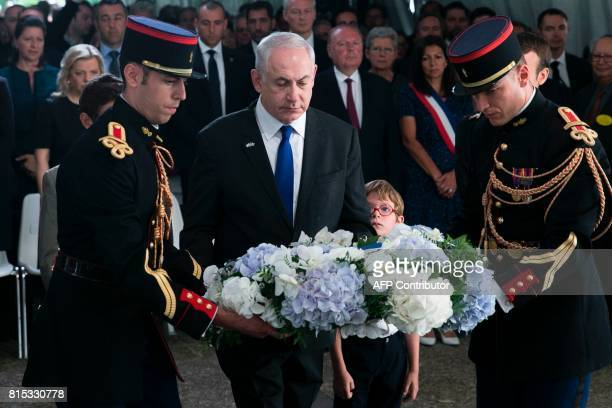 Israeli Prime Minister Benjamin Netanyahu lays a wreath during a ceremony commemorating the 75th anniversary of the Vel d'Hiv roundup in Paris on...