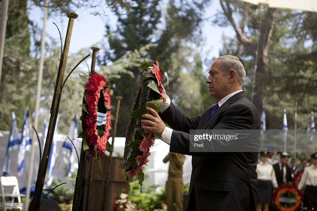 Israeli Prime Minister <a gi-track='captionPersonalityLinkClicked' href=/galleries/search?phrase=Benjamin+Netanyahu&family=editorial&specificpeople=118594 ng-click='$event.stopPropagation()'>Benjamin Netanyahu</a> lays a wreath during the state memorial ceremony for Israeli Defense Forces (IDF) soldiers fallen during the Yom Kippur War (Arab-Israeli war), on September 15, 2013 in Jerusalem, Israel. Israel is marking 40 years since the 1973 Arab-Israeli War.