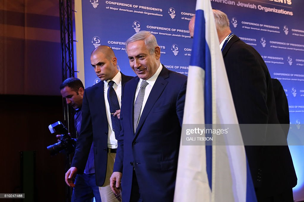 Israeli Prime Minister Benjamin Netanyahu leaves after delivering a speech at the Conference of Presidents of Major American Jewish Organizations on February 14, 2016 in Jerusalem. / AFP / GALI TIBBON